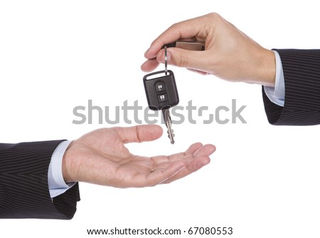 Business man giving a new key car to another man - stock photo