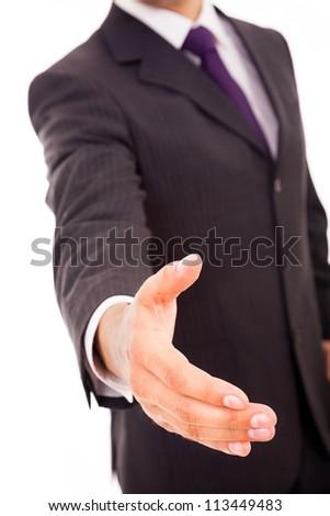 Business man giving handshake, isolated on white - stock photo