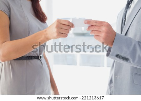 Business man giving his card to customer - stock photo