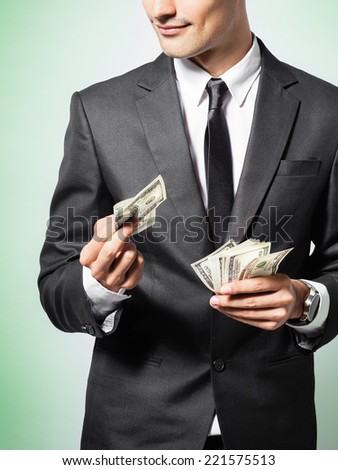Business man giving money - stock photo