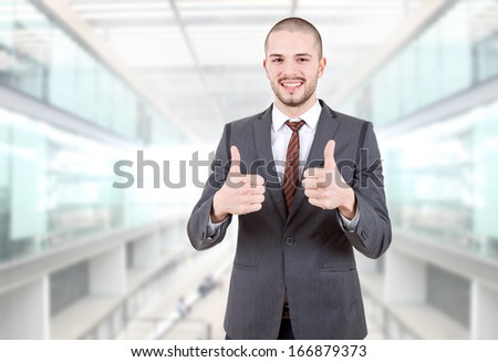business man going thumbs up at the office - stock photo