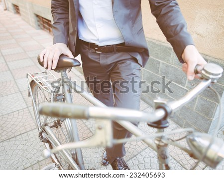 business man going to work on his bicycle. concept about healthy lifestyle - stock photo