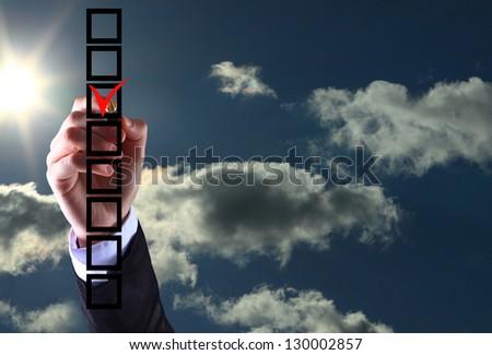 business man hand choose check mark on box - stock photo