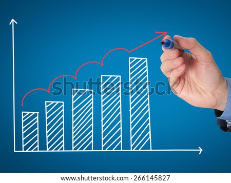 Business man hand drawing a graph. Growth concept. Isolated on blue background. Stock Image - stock photo