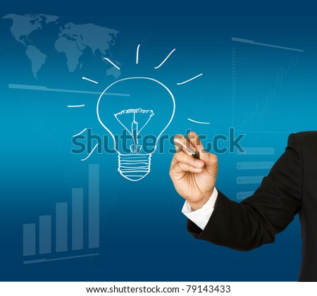 Business man hand drawing light bulb - stock photo