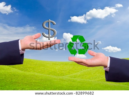 business man hand exchange dollar sign and recycle icon - stock photo