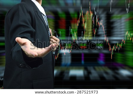 Business Man hand holding with stock market graph background - stock photo