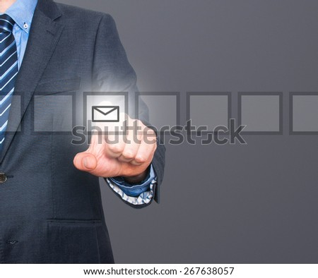 Business man Hand pressing virtual mail button. Communication concept. Isolated on grey. Stock Image - stock photo
