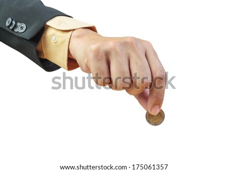 business man hand putting coin on white background - stock photo