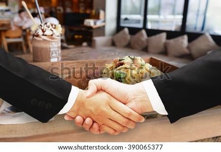 business man hand shake - stock photo