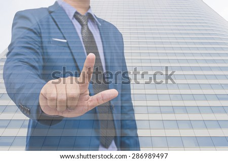 business man hand touching virtual screen - stock photo