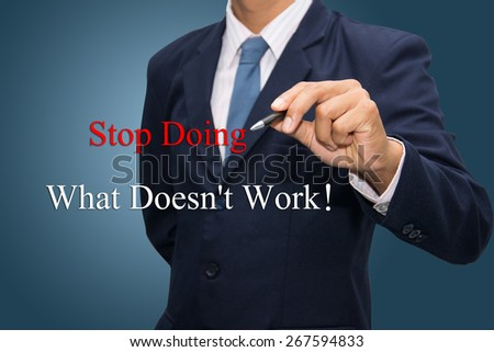 Business man hand write Stop Doing What Doesn't Work - stock photo