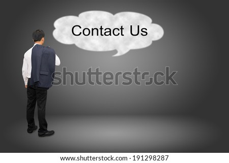 business man hand writing Contact Us  - stock photo