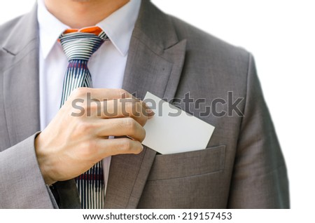 Business man handing a blank business card isolated on write background - stock photo