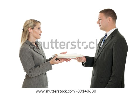 Business man handing folder to business woman isolated on white - stock photo