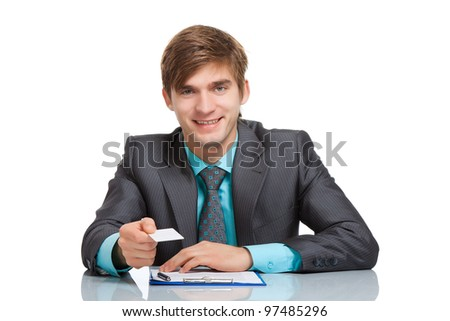Business man happy smile holding a blank business card, give visiting, credit card, dressed in elegant suit, shirt and tie, Sitting at the office desk isolated over white background, Meeting concept - stock photo
