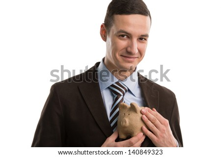 Business man hiding piggybank. Your professional finance and insurance solution for the best protection - stock photo