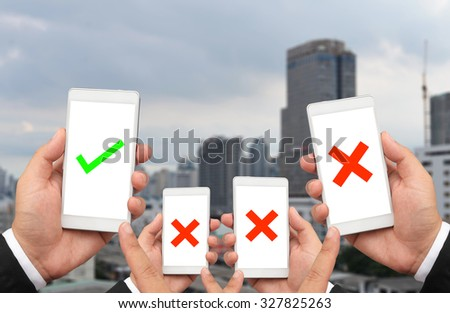 business man hold check sign on smart phone  - stock photo