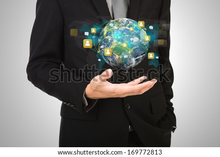 Business man hold earth of social network (Elements of this image furnished by NASA) - stock photo