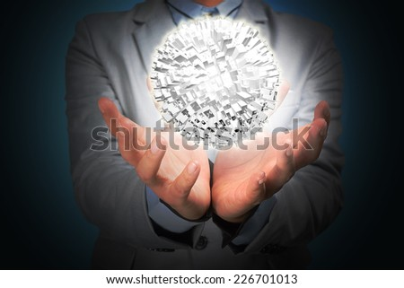 Business man hold Earth with buildings.  - stock photo