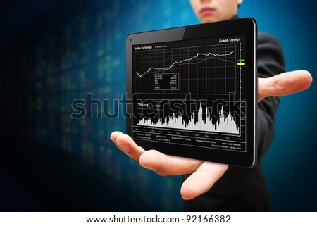 Business man hold Tablet computer and graph report - stock photo
