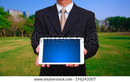 Business man hold the digital touch pad - stock photo