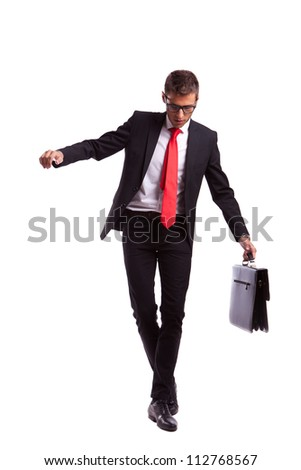 Business man holding a briefcase balancing and walking forward on an imaginary rope - stock photo