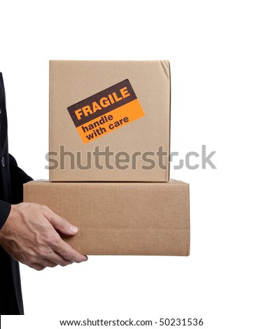 Business man holding a brown corrugated, cardboard moving box on white with copy space - stock photo