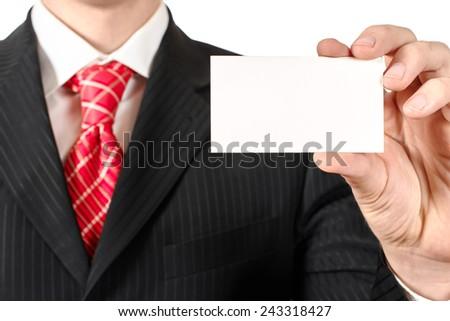 Business man holding a business card, closeup - stock photo
