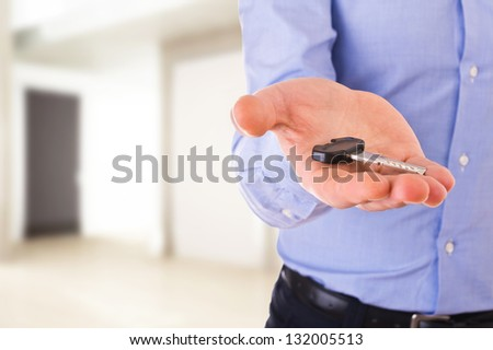 Business man holding a key. - stock photo