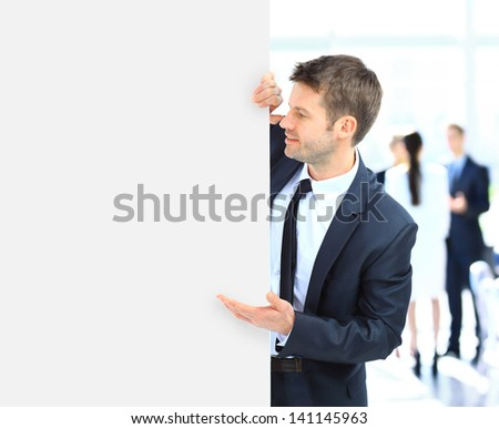 Business man holding a long blank banner - stock photo