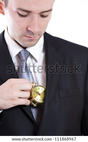Business man holding a small clock - stock photo