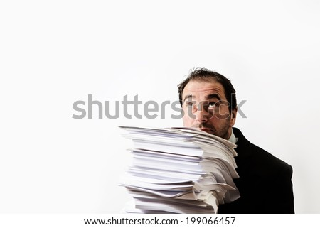 business man holding a stack of paper not looking to pleased - stock photo