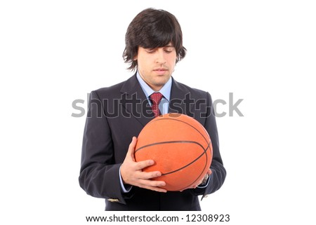 Business man holding basketball ball, isolated on white background - stock photo