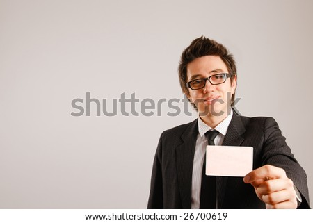 Business man holding blank business card - stock photo