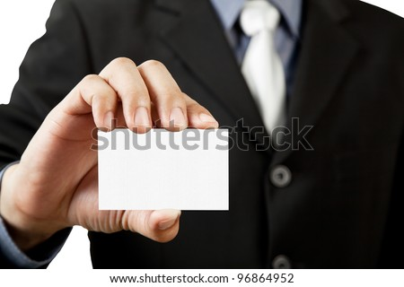 Business man holding blank business card isolated on white background - stock photo