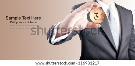 Business man holding bronze medal. Third prize concept. - stock photo