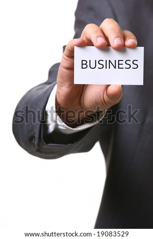 business man holding card with text BUSINESS - stock photo