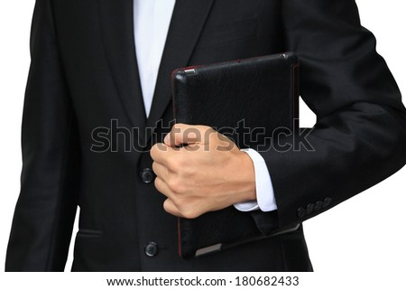 Business man holding digital tablet PC with leather case isolated on white - stock photo