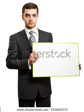Business man holding empty write board in his hands - stock photo