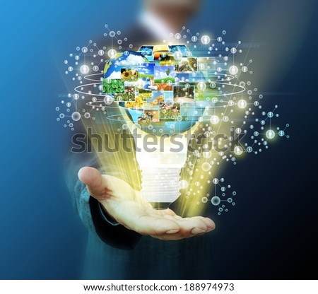 business man holding light bulb Social Network  - stock photo