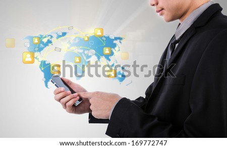 Business man holding Modern communication technology mobile phone show the social network - stock photo