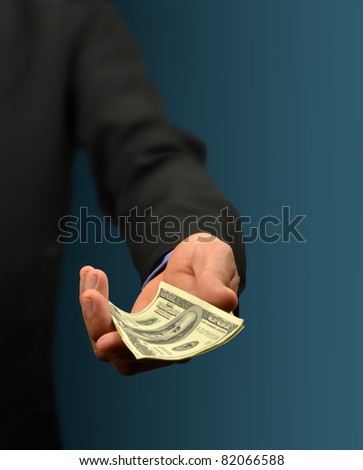 business man holding money in hand - stock photo