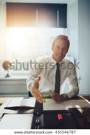 Business man holding out hand to close deal and welcome you, business partners concept - stock photo