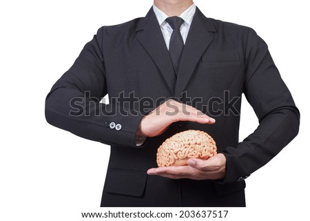 business man holding safety Intellectual property protection law and rights  copyright and patents concept protect business ideas and headhunter concepts - stock photo