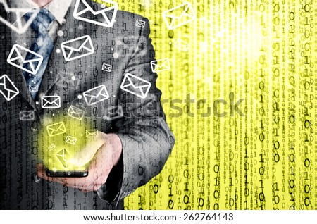 Business man holding smart phone and sending emails - stock photo