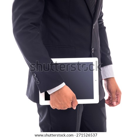 Business man holding tablet isolated on white background - stock photo
