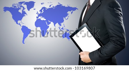 Business man holding tablet PC with world map background - stock photo
