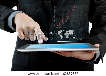Business man holding the modern digital tablet pc with success growth chart - stock photo