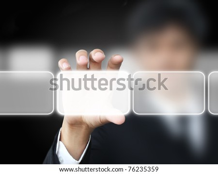 Business man holding touch screen - stock photo